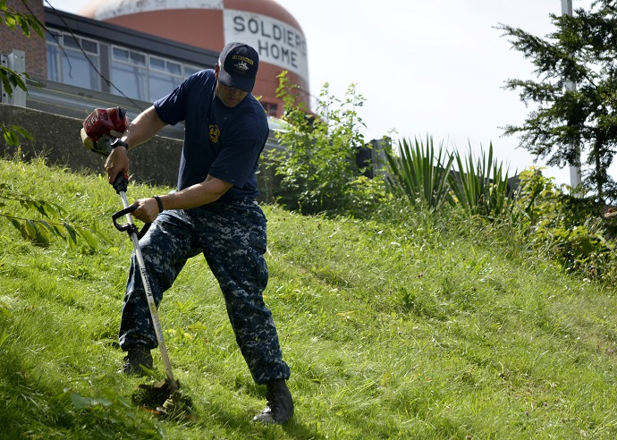 120821-N-SH953-288 CHELSEA, Mass. (Aug. 21, 2012) Chief (select) Electronics Technician James Kyne helps with landscaping during a community service project at the Soldier's Home during USS Constitution's Chief Petty Officer Heritage Week. During the week the selectees will live and train aboard USS Constitution, the world's oldest commissioned warship afloat. (U.S. Navy photo by Mass Communication Specialist 2nd Class Kathryn E. Macdonald/Released)